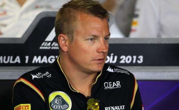 Lotus team boss Eric Boullier and Kimi Raikkonen