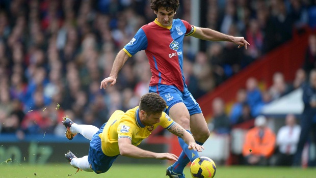Arsenal's Olivier Giroud (left) goes to ground after battling for the ball with Crystal Palace's Mile Jedinak (right)