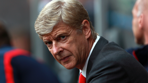 Wenger cools title talk