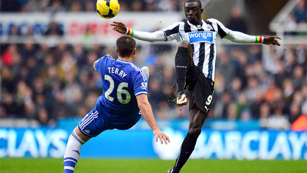 Chelsea John Terry  and Newcastle United Papiss Cisse battle for the ball