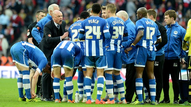Uwe Rosler Wigan Athletic manager with latics players