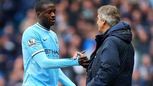 Yaya Toure and Manuel Pellegrini Manchester City