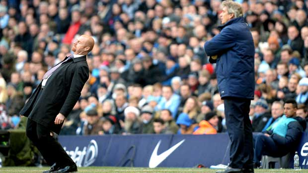 Manchester City Manuel Pellegrini and Burnley Sean Dyche