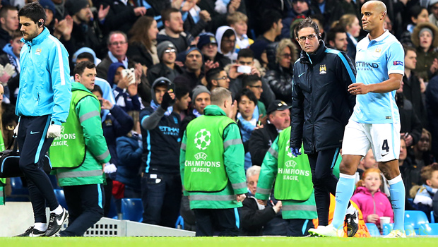 Man-City-boss-Manuel-Pellegrini-and-Vincent-Kompany