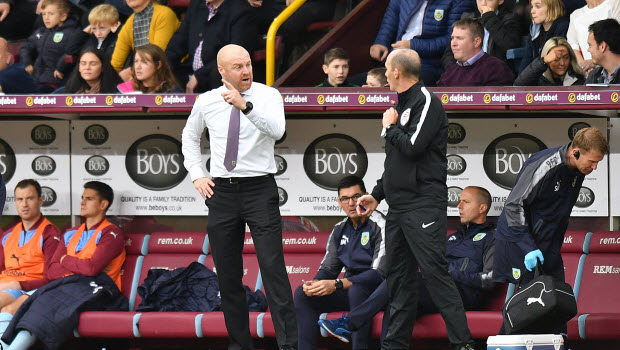 Burnley manager Sean Dyche speaks with the fourth official during the Premier League match