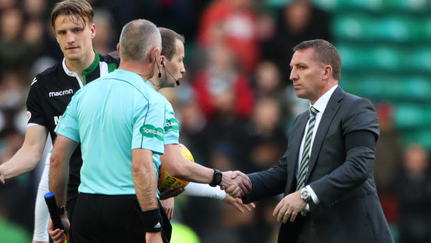 Celtic manager Brendan Rodgers shakes hands with referee William Collum