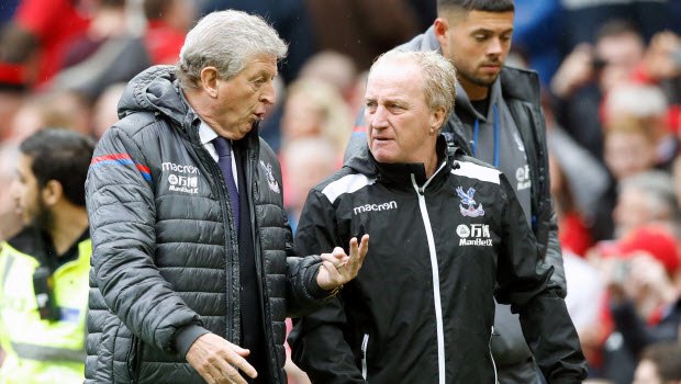 Crystal Palace manager Roy Hodgson (left) speaks to assistant Ray Lewington