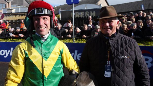 Trainer Colin Tizzard speaks to jockey Robbie Power after riding Fox Norton